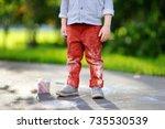 close up photo of little kid... | Shutterstock . vector #735530539