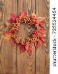 thanksgiving wreath over wooden ... | Shutterstock . vector #735534454