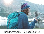 young happy traveler girl with... | Shutterstock . vector #735535510