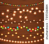 string lights on wooden wall | Shutterstock .eps vector #735536884