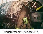 firefighter helmet on fire hoses | Shutterstock . vector #735558814