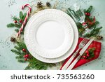 elegant christmas table setting ... | Shutterstock . vector #735563260