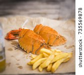 modern take on fish and chips... | Shutterstock . vector #735569878