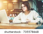 young businesswoman sitting in... | Shutterstock . vector #735578668