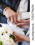 the bride and groom holding a... | Shutterstock . vector #735579634
