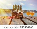 beer bottles in the vintage... | Shutterstock . vector #735584968