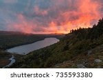 lake of the clouds sunset. a... | Shutterstock . vector #735593380