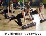 group of women doing exercises... | Shutterstock . vector #735594838