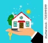 man hand holding house building ...   Shutterstock .eps vector #735599599