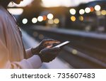 woman waiting on station... | Shutterstock . vector #735607483