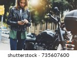 girl in leather jacket holding... | Shutterstock . vector #735607600