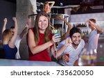 sositive female joying and... | Shutterstock . vector #735620050