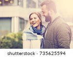 young couple hugging in the city   Shutterstock . vector #735625594