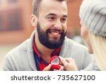adult man giving engagement... | Shutterstock . vector #735627100
