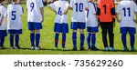 children soccer players in a... | Shutterstock . vector #735629260