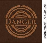 danger retro wooden emblem | Shutterstock .eps vector #735636220