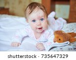 baby girl with blue eyes lies... | Shutterstock . vector #735647329