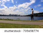man standing on the side of the ... | Shutterstock . vector #735658774