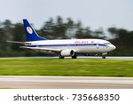 Small photo of Minsk, Minsk National Airport, Belarus - September 06, 2016: Boeing 737-300 EW-366PA Belavia Airlines landing at the airport Minsk; Speed blur