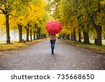 Happy Woman With Red Umbrella...