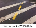 white and yellow lines on the... | Shutterstock . vector #735681814