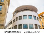 modern curved office building... | Shutterstock . vector #735682270