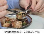 Man Eating Escargots De...