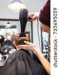 hairdresser making a hair style ... | Shutterstock . vector #735695059