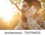 handsome hipster man talking on ... | Shutterstock . vector #735704023
