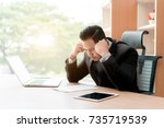 portrait of tired young asian... | Shutterstock . vector #735719539
