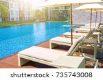 relaxing pool bed beside...   Shutterstock . vector #735743008