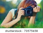 Young Woman Photographer...