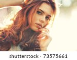 young woman outdoors portrait.... | Shutterstock . vector #73575661