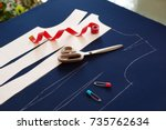 sew clothes on a pattern.... | Shutterstock . vector #735762634