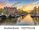 Stock photo amsterdam sunset city skyline at canal waterfront amsterdam netherlands 735792118
