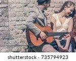 romantic young man play guitar... | Shutterstock . vector #735794923
