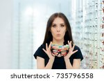funny woman holding many... | Shutterstock . vector #735796558