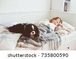happy kid girl waking up in the ... | Shutterstock . vector #735800590