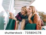happy woman with shopping bags... | Shutterstock . vector #735804178