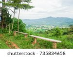 Wooden Bench On Mountain Peak...