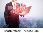 businessman using laptop with... | Shutterstock . vector #735851236