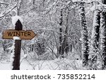 road sign with text winter in... | Shutterstock . vector #735852214