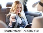 young businesswoman with tablet ... | Shutterstock . vector #735889510