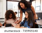 teacher helping high school... | Shutterstock . vector #735905140