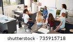 schoolgirl presenting in front...   Shutterstock . vector #735915718