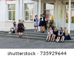 schoolgirls jump on a rope at a ... | Shutterstock . vector #735929644