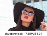 outdoor closeup portrait of... | Shutterstock . vector #735935524