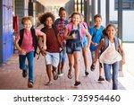 school kids running in... | Shutterstock . vector #735954460