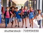 school kids running in... | Shutterstock . vector #735954550