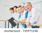 clinic team of doctors stand... | Shutterstock . vector #735971248